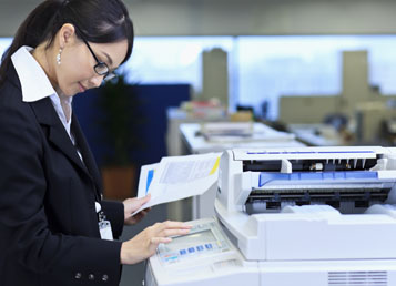 Employee collecting secure documents