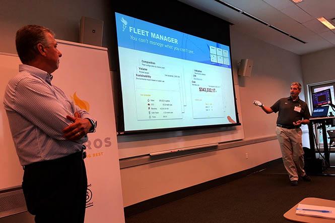 Pharos presenting Beacon to the staff of NYU